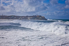 Cyclone at Bondi Beach, Sydney. With the wind whipping up powerful white breakers as they race to shore Royalty Free Stock Photos