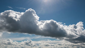 Cyclone of clouds. Large heavy white cloud carries a cyclone against the blue sky on a sunny summer day Stock Photo
