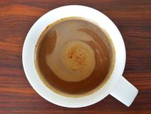 Cyclone in a cup. Top view of coffee which cream on top have form like cyclone Stock Photo