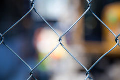 Cyclone fence background. Cyclone fence in front of blurred out cityscpae Stock Photos