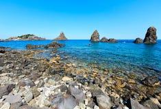 Aci Trezza Faraglioni, Sicily coast. Cyclopean Coast and the Islands of the Cyclops on Aci Trezza town Italy, Sicily,10 km north of Catania. Known as Isoles Dei stock photo