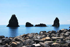 Cyclops Islands - Sicily. A view of the geological formation situated in front of the little village of Acitrezza, in the soo called Riviera dei Ciclopi, Sicily Stock Photography