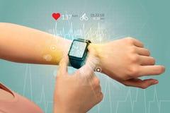 Cyclus en smartwatch concept stock afbeelding