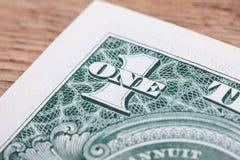 Cyfra Jeden na dolarowym banknotu zakończeniu Zdjęcie Stock