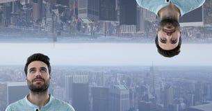 Cyfrowego złożony wizerunek mężczyzna i do góry nogami miasto Zdjęcia Royalty Free