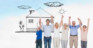 Cyfrowo wytwarzający wizerunek rodzinne mienie ręki podczas gdy stojący na polu z domem rysującym w niebie fotografia stock