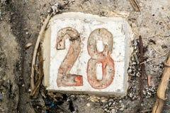 Cyfry z betonem na chodniczku 28 Fotografia Stock