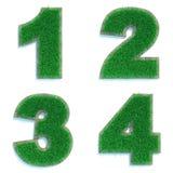 Cyfry 1, 2, 3, 4 Zielony gazon Zdjęcie Stock