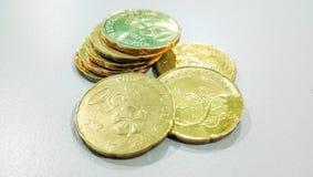 Cyilling of gouden muntstuk Stock Afbeelding