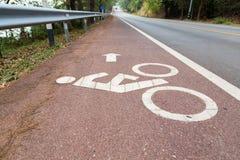 Cykellinssymbol på vägen Fotografering för Bildbyråer