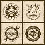 Cykeln shoppar och servar fyra färgade emblem Vektor Illustrationer