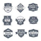 Cykelreparation - tappningvektoruppsättning av logoer Arkivfoto