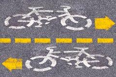 Cykeltecken på vägen arkivfoto