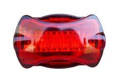Cykla den isolerade ljusa signalen, bakre lampa för röd cykel på vit bakgrund Bekläda beskådar royaltyfria bilder