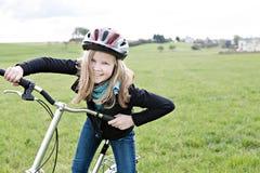 Cykla flickan Arkivbilder
