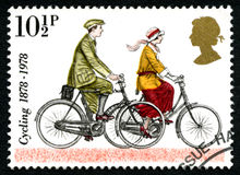 Cykla UK-portostämpeln Arkivbilder