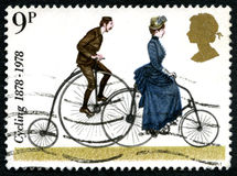Cykla UK-portostämpeln Arkivfoton