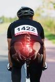 Cyklist med synliga ben Arkivbild