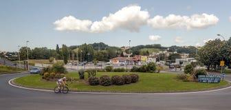 Cyklist som cirkulerar i en karusell Royaltyfri Foto