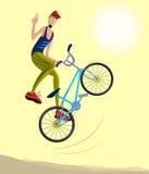 Cyklist som gör ett jippo och hopp i luften Arkivbild