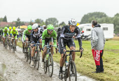 Cyklisten Niki Terpstra på en lappad väg - turnera Royaltyfria Foton