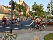 Cyklister i Singapore Arkivbild