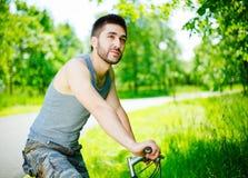 cyklistmanbarn Fotografering för Bildbyråer
