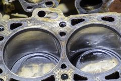 The cylinder block of the four-cylinder engine. Disassembled mot. Or vehicle for repair. Parts in engine oil. Car engine repair in the service Stock Images