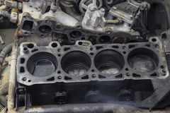 The cylinder block of the four-cylinder engine. Disassembled motor vehicle for repair. Parts in engine oil. Car engine repair in t. He service Royalty Free Stock Photo