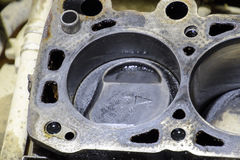 The cylinder block of the four-cylinder engine. Disassembled motor vehicle for repair. Parts in engine oil. Car engine repair in t. He service Stock Photo