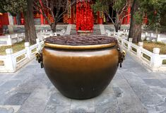 A close shot of the sea cylinder of Pu an temple of universal peace. The cylinder is called treasure bowl filled with many coins thrown by the people share their Stock Photography