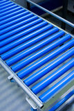 Cylinder conveyer. Part of Blue Cylinder Conveyer at plant interior Royalty Free Stock Photo