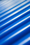 Cylinder conveyer close-up. Part of Blue Cylinder Conveyer Rolls Close-up background Stock Images
