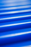 Cylinder conveyer close-up. Part of Blue Cylinder Conveyer Rolls Close-up background Royalty Free Stock Photo