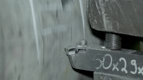 The process of grinding large metal cylindrical parts in production