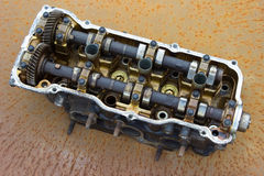 Cylinder head and bent shaft , broken engine car parts Royalty Free Stock Photos