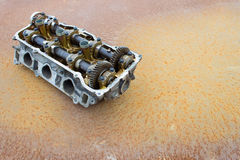 Cylinder head and bent shaft, broken engine car parts Royalty Free Stock Images