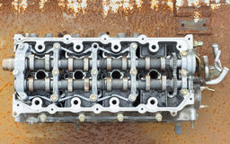 Cylinder head and bent shaft, broken engine car parts Royalty Free Stock Photography