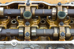 Cylinder head on rusty Stock Images