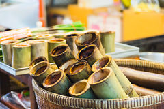 Cylinder Lam. (Sticky rice in bamboo) in basket stock photo