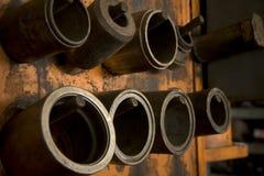 Cylinder Molds on Storage Rack Royalty Free Stock Photo