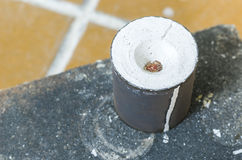 Cylinder with molten metal and plaster inside. Royalty Free Stock Photo