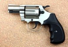 Cylinder revolver handgun over wooden background. Royalty Free Stock Photo