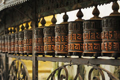 Cylinders praying in Nepal Stock Photo