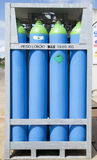 Cylinders of refrigerant. Four blue cylinders of refrigerant Stock Photo