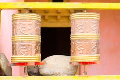 Cylinders with Tibetan symbols for reading mantras. Religion concept royalty free stock photos