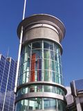 Cylindrical entrance to shops. Basingstoke, United Kingdom - May 22 2013:   A Cylindrical glass tower that is the entrance to Festival Place shoping Centre Royalty Free Stock Image