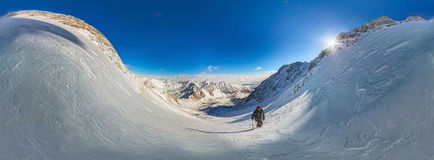 360 Cylindrical panorama of mountain hiker to climb a mountain o. F snow couloir royalty free stock image