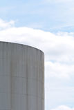Cylindrical storage tank on industrial estate Royalty Free Stock Image