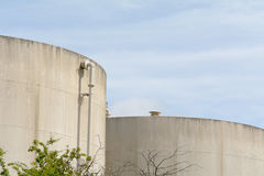 Cylindrical storage tanks on industrial estate Stock Photos
